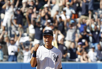 New York Yankees Derek Jeter pumps his fist after beating the Tampa Bay Rays in their MLB American League baseball game at Yankee Stadium in New York
