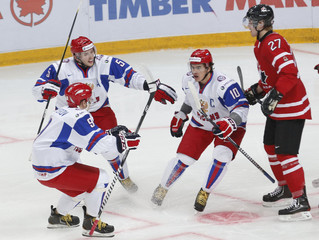 Russia's Yakupov celebrates his goal with teammates Nesterov and Yarullin as Canada's Hamilton skates past during the first period of their bronze medal game at the 2013 IIHF U20 World Junior Hockey Championship in Ufa