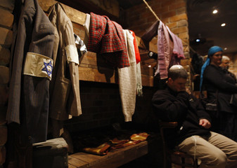 A visitor sits inside a reconstructed bunker at the museum in Kibbutz Yad Mordechai
