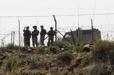 Israeli soldiers patrol the Lebanon-Israel border as seen from the southern Lebanese   village of Wazzani