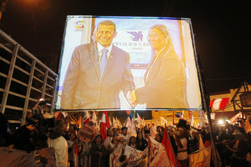 Supporters of Peru's presidential candidate Ollanta Humala watch a live telecast of the debate between presidential candidates outside a hotel in Lima