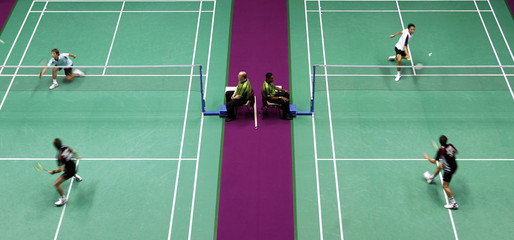 Referees are seen during singles matches at the 2010 Badminton World Championships in Paris