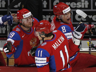 Russia's Kokarev, Malkin and Ovechkin celebrate scoring during their 2012 IIHF men's ice hockey World Championship semi-final game with Finland in Helsinki
