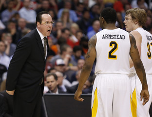 Wichita State Shockers head coach Marshall yells at his players Armstead and Baker in the first half of their West Regional NCAA men's basketball game against the La Salle Explorers in Los Angeles