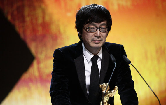 """Chinese director Diao receives the Golden Bear for Best Picture for the movie """"Black Coal, Thin Ice"""" during the awards ceremony of the 64th Berlinale International Film Festival in Berlin"""
