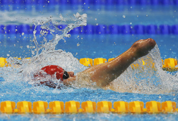 Britain's Fraser competes in the heats of the men's 100m Backstroke - S8 during the London 2012 Paralympic Games in the Olympic Park