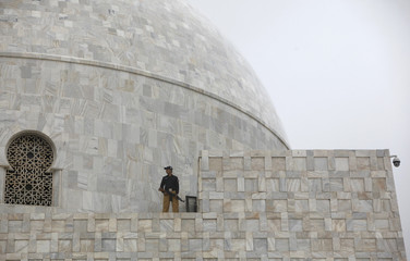 A policeman stands guard, during a ceremony to celebrate the country's 67th Independence Day at the mausoleum of Muhammad Ali Jinnah in Karachi