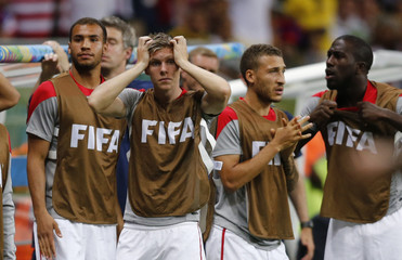 The U.S. bench reacts after their team missed a goal scoring opportunity at the last minute of extra time against Belgium during their 2014 World Cup round of 16 game at the Fonte Nova arena in Salvador