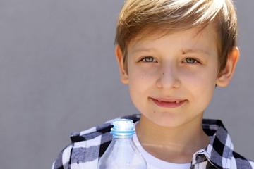 Blonde boy drinking clean water. Healthy lifestyle
