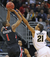 Texas Tech's Reese shoots under pressure from Missouri's Bowers in Kansas City, Missouri