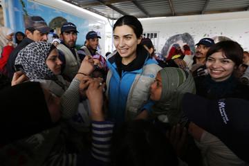 Turkish actress and UNICEF goodwill ambassador Buyukustun speaks with Syrian refugee children at the Zaatari refugee camp in Mafraq