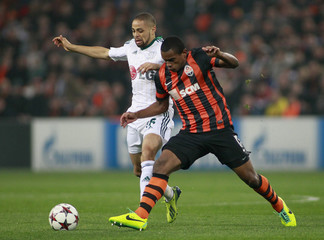 Shakhtar Donetsk's Fernando fights for the ball with Bayer Leverkusen's Sidney Sam during their Champions League soccer match at the Donbass Arena stadium in Donetsk