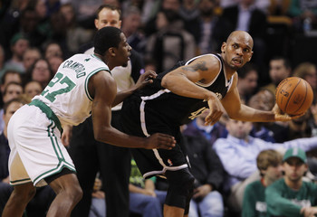 Brooklyn Nets' Stackhouse looks to pass against Boston Celtics' Crawford in the second half of their NBA basketball game at TD Garden in Boston
