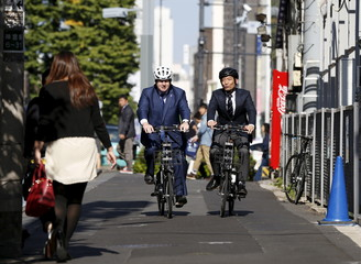 London's Mayor Johnson cycles with Tokyo's Shibuya district mayor Ken Hasebe during a bicycle share scheme event in Tokyo