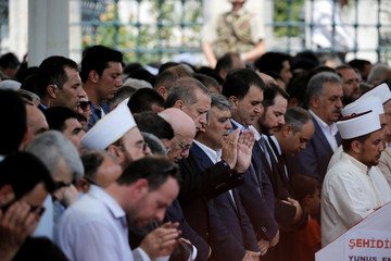Turkish President Recep Tayyip Erdogan prays during a funeral service for victims of the thwarted coup in Istanbul at Fatih Mosque in Istanbul