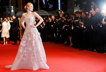 "Cast member Elle Fanning  arrives on the red carpet ahead of the screening for the film ""The Neon Demon"" in competition at the 69th Cannes Film Festival in Cannes"