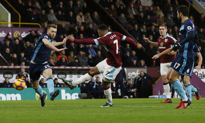Burnley's Andre Gray scores their first goal