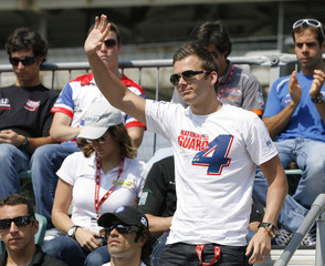 Panther Racing driver Dan Wheldon, of England, waves to the crowd during the drivers meeting at the Indianapolis Motor Speedway in Indianapolis