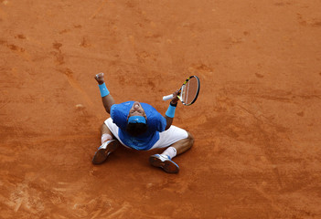Nadal of Spain reacts after winning his semi-final match against Murray of Britain at the French Open tennis tournament at the Roland Garros stadium in Paris