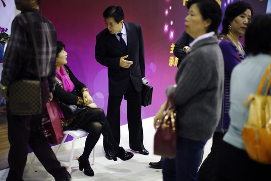 A man and a woman chat during a government-sponsored matchmaking event for middle-aged singles and seniors in Shanghai