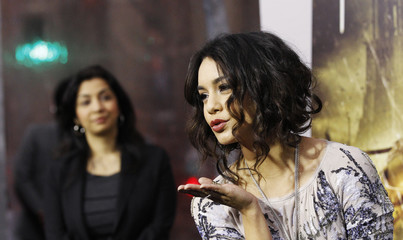 """Hudgens blows a kiss at photographers at the premiere of """"Sucker Punch"""" at the Grauman's Chinese theatre in Hollywood"""