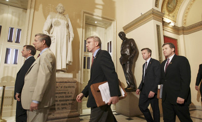 Republican members of the House of Representatives walk on Capitol Hill in Washington