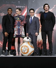 """Director Abrams, cast members Boyega, Ridley, and Driver pose for pictures with Star Wars character BB-8 during a news conference for their upcoming movie """"Star Wars: The Force Awakens"""" in Urayasu"""