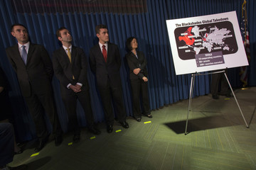 """Employees working with the U.S. Attorney for the Southern District of New York stand next to a display referring to """"BlackShades"""" malware during a news conference to announce law enforcement action to target creators and purveyors of malicious computer so"""