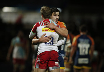 Worcester Warriors' Michael Dowsett and Harlequins Charlie Walker at the end of the game