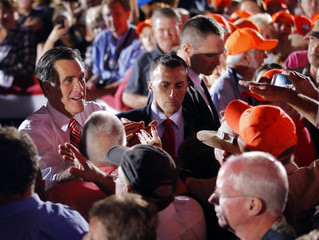 Republican presidential nominee Romney greets audience members at a campaign rally in Fishersville