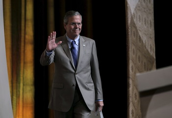 "Republican presidential candidate Jeb Bush waves as he arrives to address a legislative luncheon held as part of the ""Road to Majority"" conference in Washington"
