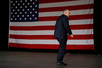 Former New York mayor Giuliani leaves the stage after speaking at a rally with Republican U.S. presidential nominee Trump in St. Augustine, Florida