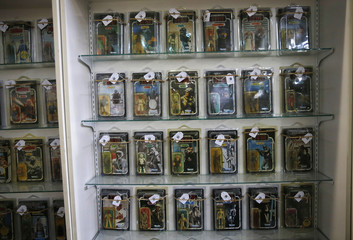 Vintage Star Wars toys in their original packaging wait to be sold ahead of an auction of Star Wars and film related toys at the Vectis auction house in Stockton-on-Tees