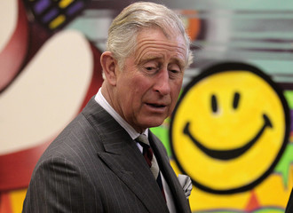 Britain's Prince Charles walks past a 'smiley face' during a visit to the North West Youth Project in Kilmarnock, Scotland