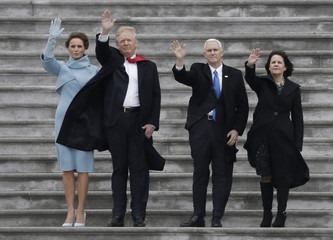 President Donald Trump, Melania Trump, Vice President Mike Pence and Karen Pence wave as the Executive One helicopter departs carrying outgoing President Barack Obama and outgoing First Lady Michelle Obama following Trump's swearing ceremony in Washington