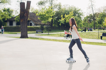 Pretty young woman in roller skates