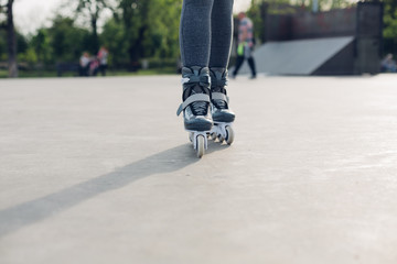 Closeup of a roller girl in skate park
