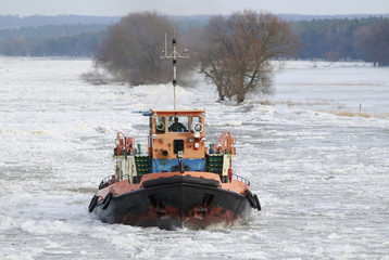 An ice breaker crushes ice that covers river Oder in Schwedt/Oder at border crossing to Poland