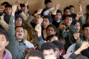 Students shout sloganst as they attend a gathering by Houthi loyalists against Saudi-led air strikes in Yemen's capital Sanaa