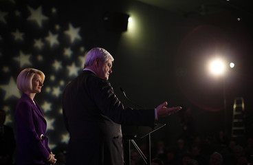 Gingrich speaks at the Veterans for a Strong America Presidential Forum as his wife Callista looks on in Des Moines, Iowa