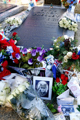 Flowers and birthday wishes from around the world lie beside the grave of Elvis Presley at his home at Graceland in Memphis