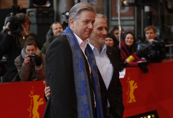 Berlin mayor Wowereit and partner Kubicki arrive at the red carpet for screening of movie 'Schlafkrankheit' at 61st Berlinale International Film Festival in Berlin