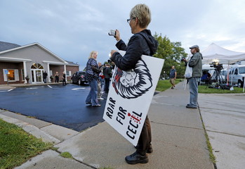 Protester takes photo of the River Bluff Dental clinic after American hunter Walter Palmer arrives in Bloomington