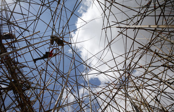 Professional rock climbers work on an art installation in Jerusalem