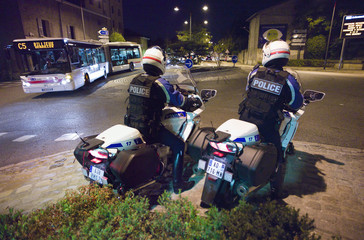 French motorcycle police participate in a night traffic control of cars and motorcycles in Rillieux