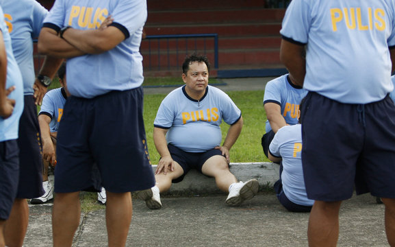 Police take a break during their Weight Loss Management Program at Camp Crame in Quezon City Metro Manila