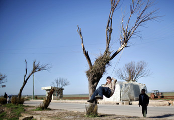 Boys play outside their house in the countryside of Aleppo