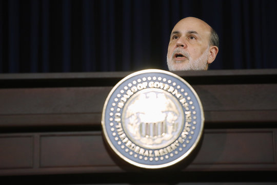 U.S. Federal Reserve Chairman Bernanke responds to reporters during his final planned news conference before his retirement, at the Federal Reserve Bank headquarters in Washington