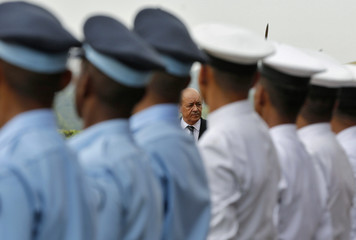 French Defence Minister Le Drian is seen through a line of Indian soldiers during his ceremonial reception in New Delhi