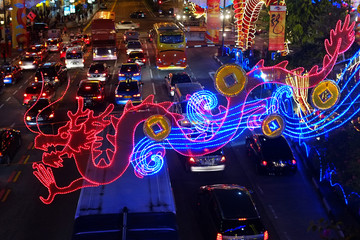 Dragon-design light decoration for the upcoming Chinese Lunar New Year is seen above cars on a street in Singapore